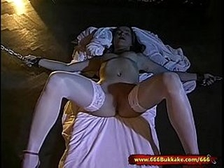 Dirty young Slut is in chains used, fucked and cum covered by a group of horny men!